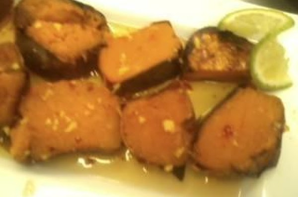 Place cut sweet potatoes on a sheet pan and drizzle with olive oil and...