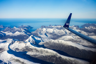 Photo: B737 winglet over Kvaløya, an island in Troms, Northern Norway, as seen on climbout from Tromsø southwards