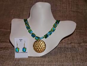 Photo: <BEREHYNYA> {Great Goddess Protectress} unique one-of-a-kind statement jewellery by Luba Bilash ART & ADORNMENT  Metal disk pendant, foil glass, 14K gold vermeil SOLD/ПРОДАНИЙ