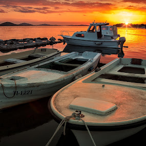 Sunset over boats by Branko Meic-Sidic - Transportation Boats ( croatia, sky, orange, seascape, pirovac, waterscape, sunset, porat, dramatic, boats, prosika, sea )