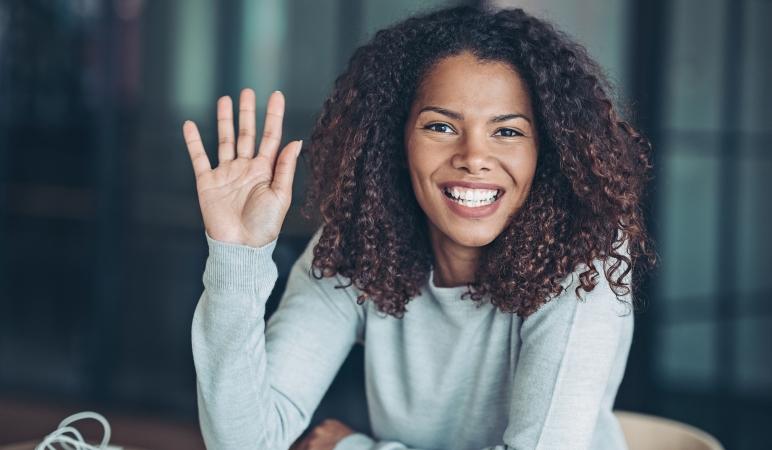 woman waving hello