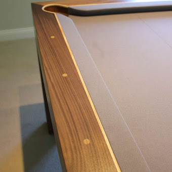 detailing on the edge of the refined pool table