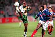 Bafana Bafana striker Philemon Masinga is challenged by a France defender Marcel Desailly  during their 1998 World Cup clash in France.