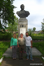 Photo: Liz and I pose with Victor in front of the monument to Grigoriy Rechkalov, one of the most decorated Soviet pilot during WWII (and hailing from Irbit, near our field station)