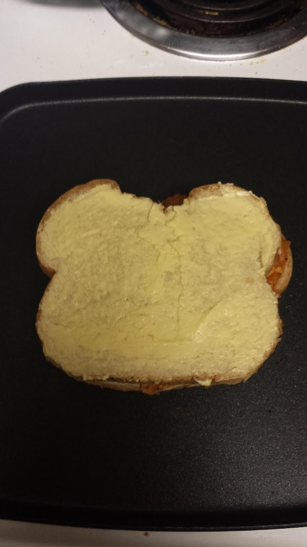 Place the other slice of bread on with the buttered side on top.