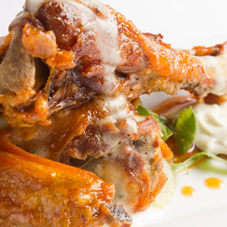 Chile-Glazed Crispy Confit Duck Wings with Blue Cheese CrèMe Fraiche and a Shaved Celery and Grape Salad Recipe