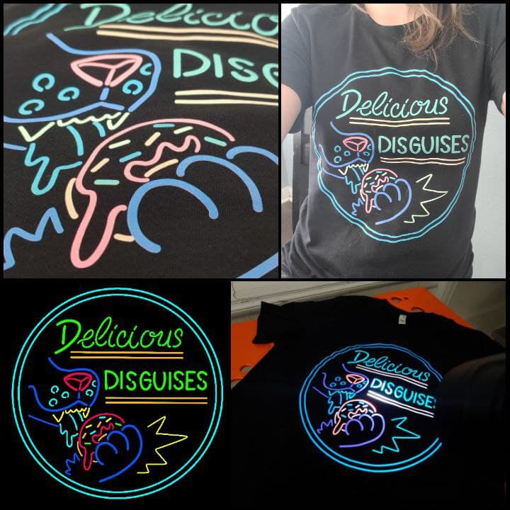 UV Reactive Logo T-Shirt - $25  Durable shirts, soft and comfy. Available in S, M, L, XL, 2XL, 3XL, 4XL. Sizes are unisex.  Sizes 2XL and up are $5 extra   Enter sizes and quantities desired: