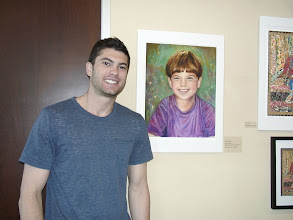 Photo: Ari with his portrait by his grandmother, Sydelle. / 4-21-13 Les & Sydel Art exhibit at Weissman Ctr
