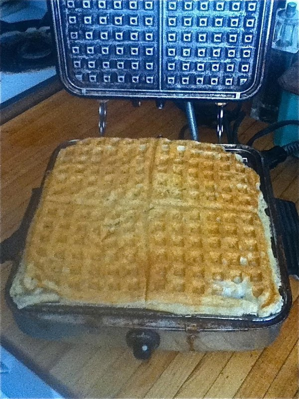 Waffles are done when you can lift the lid of waffle iron off from...
