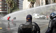 Police disperse  Nehawu members using a water canon and stun grenades in front of parliament during their nationwide strike over public servant's salaries and providing personal protective equipment for health and frontline workers.