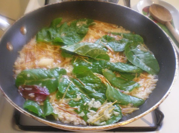 Add rice, chard, and chicken broth.  Cook for 7 minutes until pasta is...