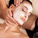 a lady receiving a 30 minute facial