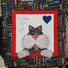 Photo: HBH102 Pet Lover's Bag by Karen Walker of Quilter's Confectionery, Warrenton, Virginia. Who wouldn't want to have this colorful cat bag to tote back and forth to class
