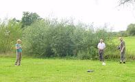Photo: Exploring a field adjoining the church at Deerhurst.