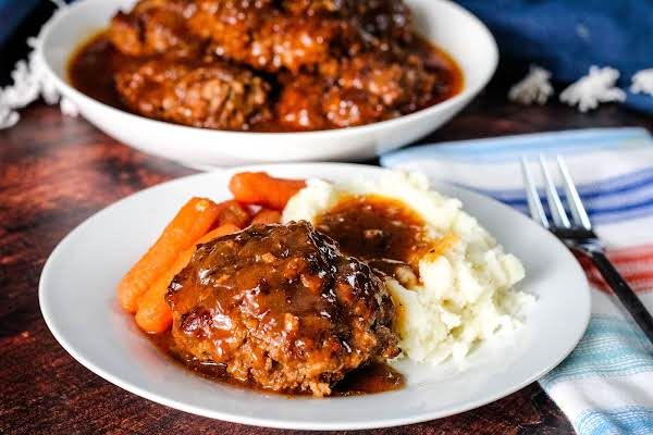 Sea's Salisbury Steak On A Plate With Mashed Potatoes And Carrots.
