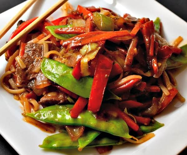 This Beef Lo Mein Combines Tender Beef, Onions, Peppers, Carrots, Celery, Cabbage, Snow Peas And Rice Noodles In A Slightly Spicy Ginger Soy Sauce.