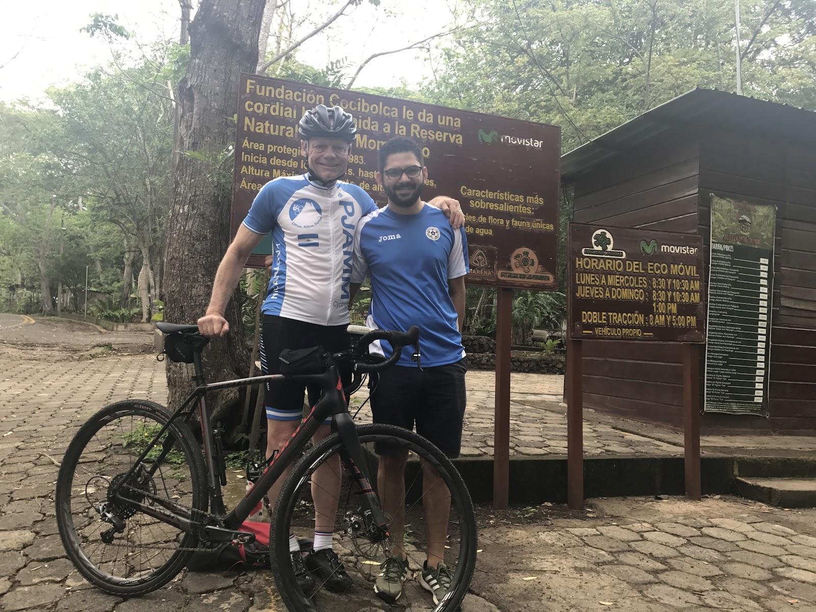 Biking up Mombacho Volcano - cyclist at sign