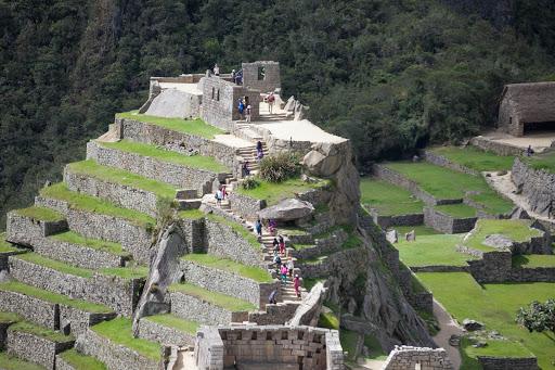 Terraced hills lead to the ruins of a citadel at Machu Picchu, Peru.