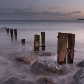 Youghal Strand 3-2-2018 by John Holmes - Landscapes Sunsets & Sunrises ( colour, old, winter, wood, groynes, sunset, blue hour, waves, sea, breakers, rocks, white water, weathered )