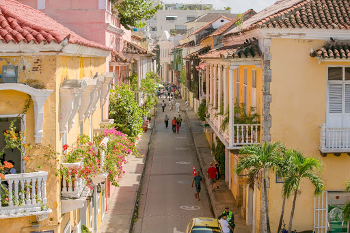 cartagena-alleyway.jpg - Visitors stroll a pretty street in Old Cartagena.