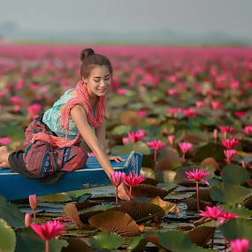 Pink lotus by Visoot Uthairam - People Portraits of Women ( thailand, thai, leaf, people, lotus, girl, village, nature, farmer, woman, lifestyle, asia, pink, pond, flower, water, work, collecting, green, beautiful, lake, young, portrait, rural, amazing, aquatic, local, garden )
