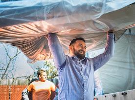 Man carrying a mattress