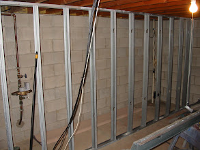Photo: Front wall showing what will be access to water meter, sump pump and storage.
