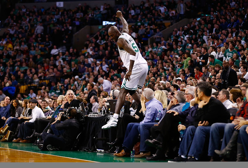 Photo: BOSTON, MA - JANUARY 4:  Kevin Garnett #5 of the Boston Celtics  climbs over a table to reenter the game after leaping into the seats courtside seats attempting to grab a loose ball against the Indiana Pacers during the game on January 4, 2013 at TD Garden in Boston, Massachusetts. NOTE TO USER: User expressly acknowledges and agrees that, by downloading and or using this photograph, User is consenting to the terms and conditions of the Getty Images License Agreement. (Photo by Jared Wickerham/Getty Images)