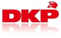 Sich vertikal spiegelndes DKP-Logo.