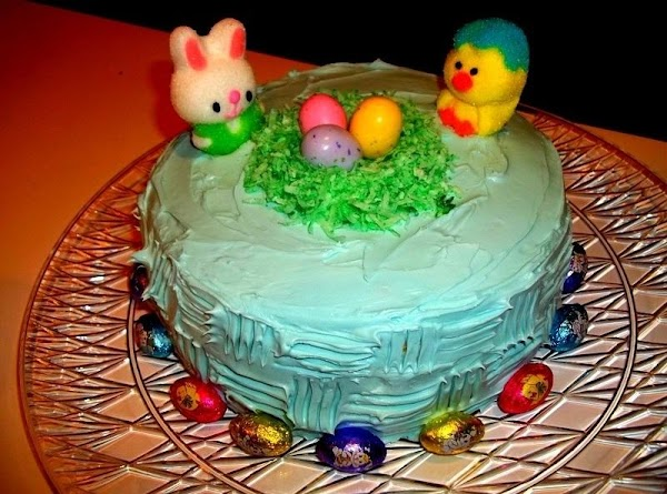 """Place the coconut on the top center of the cake to make a """"nest.""""..."""