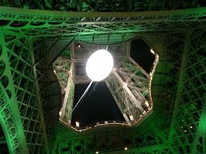 Photo: Eiffel Tower with a huge 2007 Rugby World Cup balloon on display (big white ball in the photo)