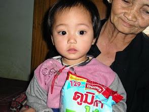 Photo: Baby and Grandmother receiving formula milk at Rejoice clinic in Fang.