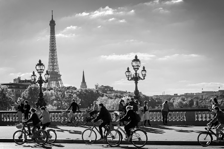 Paris, France - September 27, 2015: People on bicycles and pedestrians enjoying a car free day on Alexandre III bridge