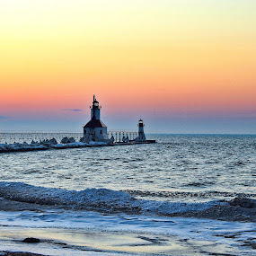 Lighthouse in the Afterglow by Jennifer Smusz - Landscapes Sunsets & Sunrises ( #pier, #michigan #lighthouse #lake #winter #icy #ice #sunset #afterglow #beach #stjoseph #puremichigan, #peaceful )