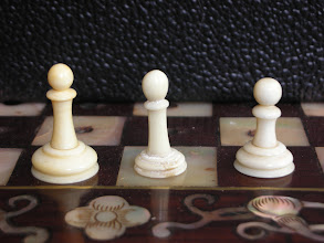 Photo: Comparison of pieces in three Cantonese ivory travel sets  Pawns  As with the knights, the tallest pawn accompanies the shortest king!