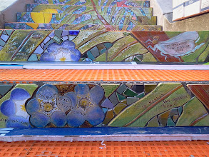 Photo: Foreground: detail of the top step of the third flight (from top of the Hidden Garden Steps, on 16th Avenue, between Kirkham and Lawton streets in San Francisco's Inner Sunset District), installed on October 29, 2013. KZ Tile workers finished installing more than 36 pieces of the 148-step ceramic-tile mosaic designed and created by project artists Aileen Barr and Colette Crutcher. For more information about this volunteer-driven community-based project supported by the San Francisco Parks Alliance, the San Francisco Department of Public Works Street Parks Program, and hundreds of individual donors, please visit our website at http://hiddengardensteps.org.