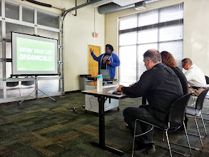 Photo: HandsOn Tech Atlanta and volunteer Maurice Cherry, of 3eighteen Media, train local nonprofits on email marketing do's and don'ts.