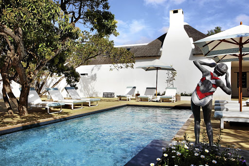 The pool  and deck at The Old Rectory have been built around the centuries-old milkwood trees.