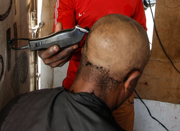 A number of salons and street barbers say they clean their machines after each client.
