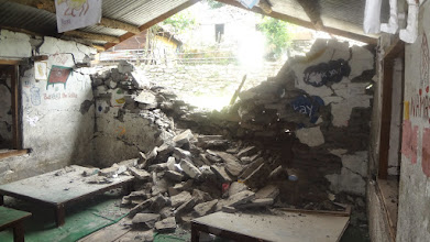 Photo: The crumbled wall of the children's library at Tutleswori Primary School.