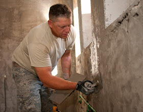 Photo: U.S. Air Force Master Sgt. Donald Maier, 219th RED HORSE Squadron, puts a layer of skim coat on a bathroom wall at an elementary school in Ogulin, Croatia, June 21, 2014. The school bathrooms are being renovated by Airmen from the 133rd and 148th Civil Engineering Squadron, and 219th RED HORSE Squadron in partnership with the Croatian army. Croatia is a Minnesota state partner under the National Guard State Partnership Program. (U.S. Air National Guard photo by Staff Sgt. Austen Adriaens/Released)