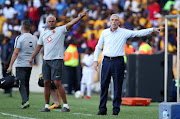 Kaizer Chiefs head coach Ernst Middendorp (R) and his assistant Shaun Bartlett dish out instructions during a match.