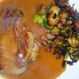 Festive Pork Chop's in an Orange Sauce with Sauteed Brussel Sprout's and Chesnut's.