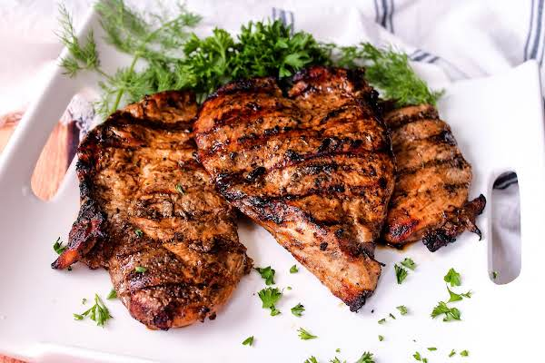 Three Balsamic Grilled Chicken Breasts On A Plate.