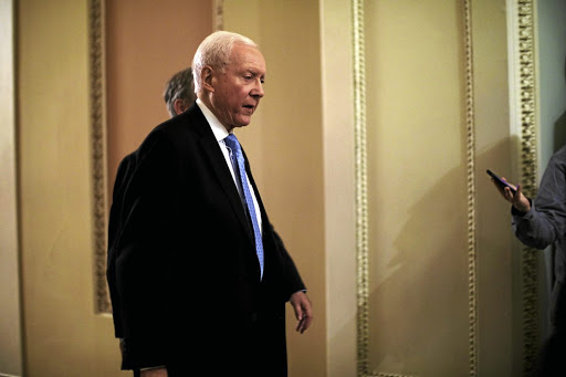 Republican Senator Orrin Hatch leaves the Senate floor during votes on the Republican tax plan in Washington on November 30 2017. Picture: REUTERS