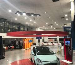 A car showroom with an electrical design