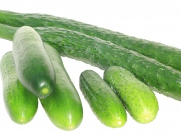 Wash the cucumbers and score with a fork or remove part of the skin.
