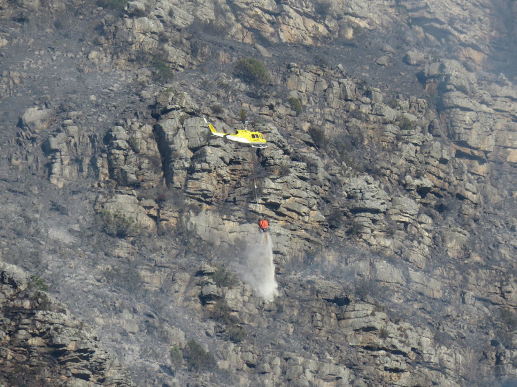 Firefighters battle the flames at Skeleton Gorge, Table Mountain.