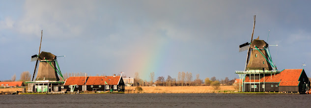 Photo: This is a recent photo from Zaanse Schans in Holland, where I was fortunate enough to spot a rainbow in amongst the windmills. On the downside, the rainbow only lasted for about 2 minutes from the time I first saw it so I didn't exactly have a lot of say in the angle for this shot!  For #WideWednesdayPanorama , curated by +Andrew Marston, +Lucille Galleli and +Ken McMahon