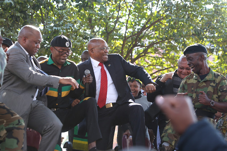 Former president Jacob Zuma dancing outside the Pietermaritzburg High Court after his third appearance on charges of fraud and corruption on July 27, 2018.